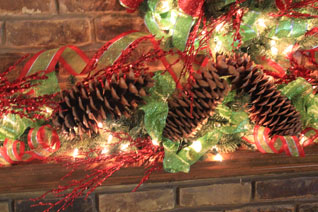 close-up of pinecones w/ red & green decor