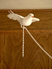 Left bird with beads